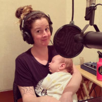Woman holding baby in recording studio
