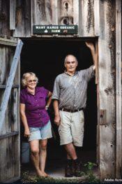 Jack and Julie in barn door by Oliver Scott Snure